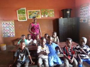 the younger class with their teacher in Elmina.