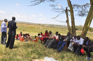 Maasai tribe's bible study with a Highway of Holiness Pastor after receiving new bibles.